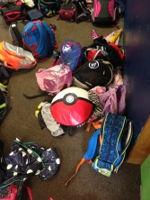 pile of dirty backpacks